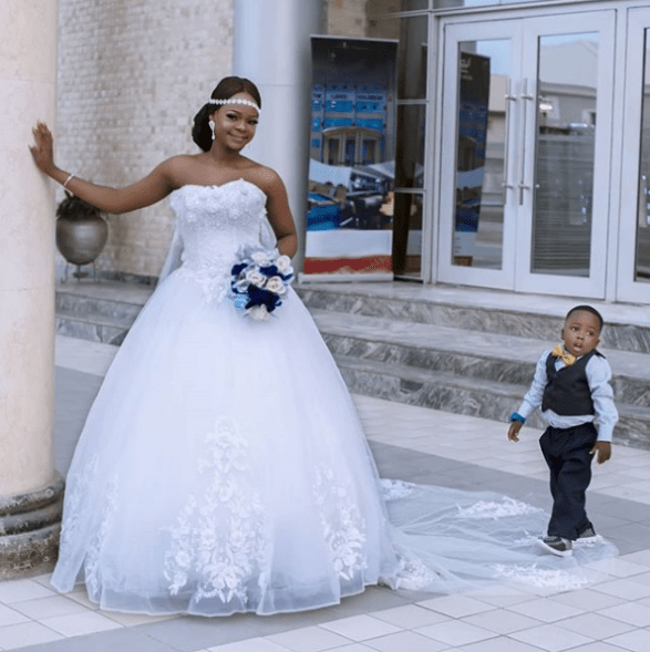 Olajumoke and little viral photobomber wow in wedding shoot Untitled 222