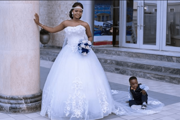 Olajumoke and little viral photobomber wow in wedding shoot Untitled 224 1