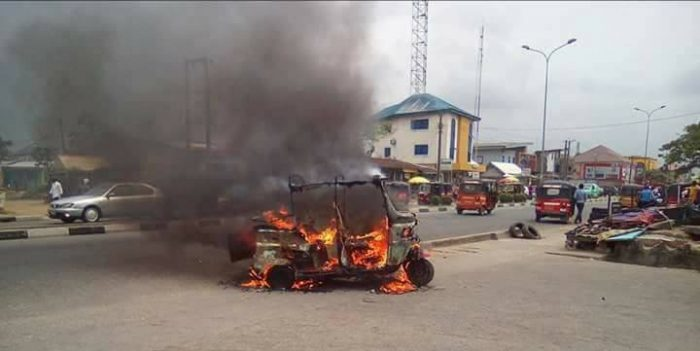 Pictures: Angry Mob Apprehend Scammer, Set Ablaze His Tricycle armi2 700x351