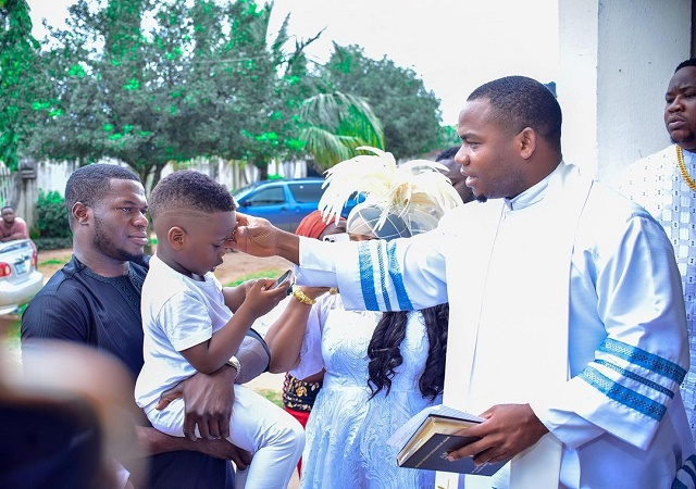 """""""My Son Pulled Up To the House Of God for Baptism on All White"""" – Cubana Chief Priest Says As Son Undergoes Water Baptism (PHOTOS)"""